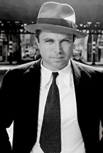 King Vidor in a suit and hat
